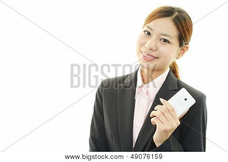 Business woman smiling with a mobile phone