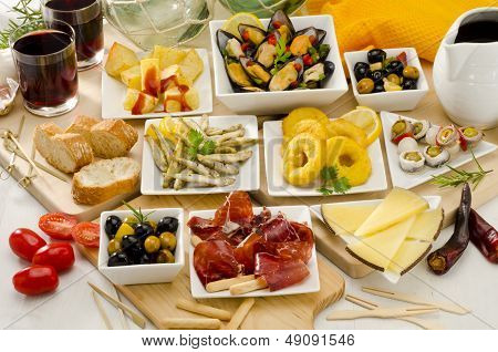 Spanish Cuisine. Variety Of Tapas On White Plates.