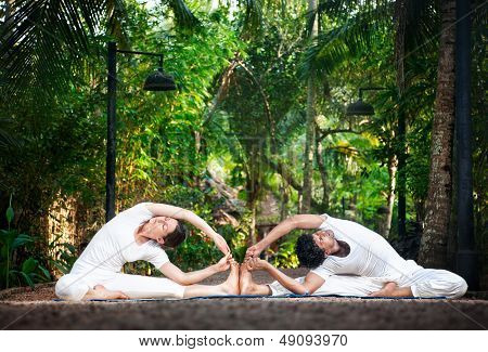 Couple Yoga In The Garden