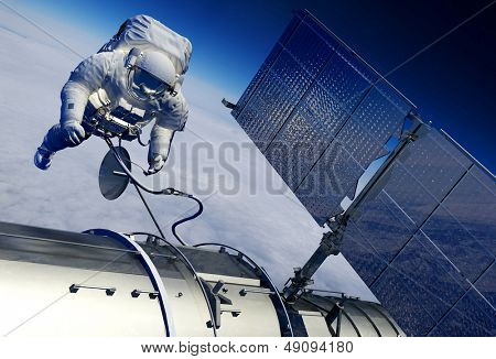 Astronaut and space station in space.