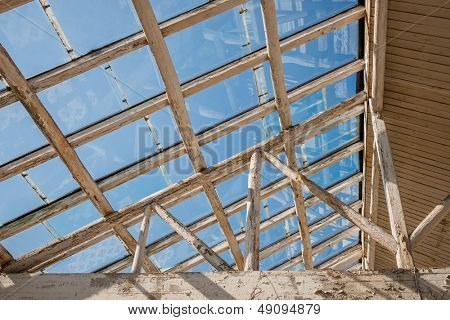 glass skylight in the sunshine of wooden house.