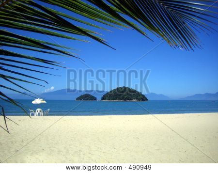Brazilian Beach With A Chair And An Island