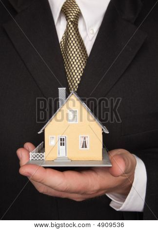 Businessman Holding House