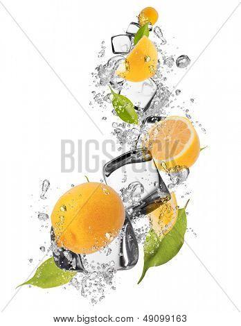 Fresh lemons with ice cubes, isolated on white background