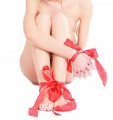 picture of bow-legged  - Female legs and hands with red ribbons on them - JPG