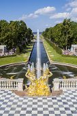 SAINT_PETERSBURG, RUSSIA - JULY 27: Peterhof palace park main channel with fountains on July 27, 201