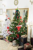 picture of cozy hearth  - Christmas tree and fireplace in the living room decorated for the new year - JPG