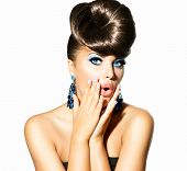 Fashion Surprised Model Girl Portrait with Blue Eyes and Earrings. Creative Hairstyle. Hairdo. Make