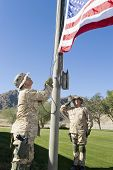 picture of military personnel  - Soldiers raising United States flag against the sky - JPG