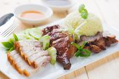 Roasted duck, roasted pork crispy siu yuk and Charsiu Chinese style, served with steamed rice on din