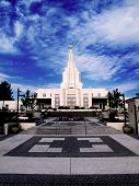 Mormon Temple with blue sky and clouds in background