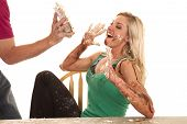 stock photo of pie-in-face  - A woman is getting a pie thrown in her face - JPG