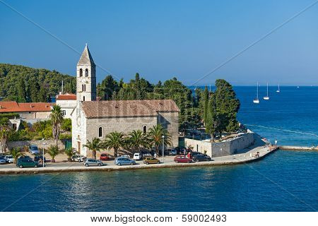 VIS, CROATIA - AUGUST 19, 2012: St. Juraj church, the first sight which greets visitors to on arrival to Vis, the furthest Croatian inhabited island.