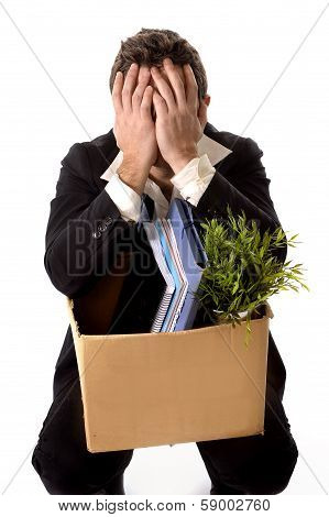 Messy Young Business Man With Cardboard Box Fired From Job