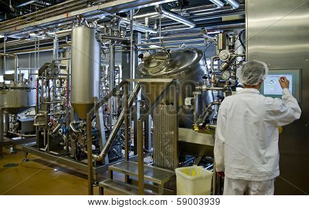 JUVASKULA, FINLAND - DECEMBER 18: Valio factory. Cheese production on February 14, 2013 in Jyvaskyla, Finland. Valio is one of biggest companies in Finland, produces dairy products