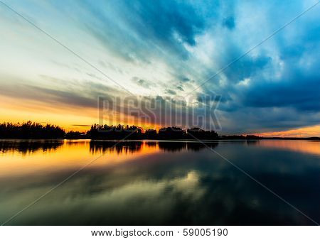 Amazing sunset sky reflection in the river