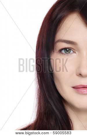 Face of beautiful middle-aged woman with clean make-up over white background