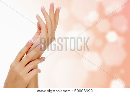 Female hands against an abstract background with circles and copyspace