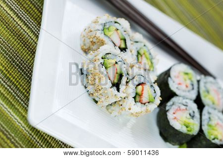 Angled Shot Of Handmade Sushi On Serving Plate