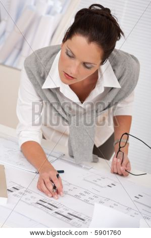 Female Architect Watching Plans