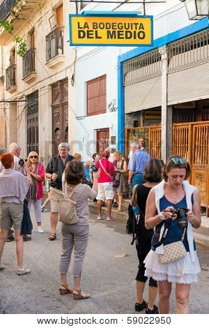 HAVANA, CUBA - JANUARY 20, 2014: Tourists visiting the famous restaurant La Bodeguita del Medio in Old Havana.The tourism industry received over 2.8 million foreign visitors in 2013