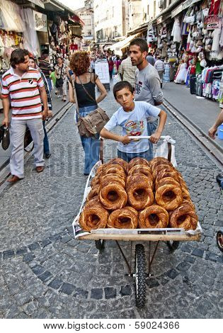 ISTANBUL, TURKEY - JUNE 25, 2010: Grand Bazaar, Unknown Teen sells bagels, June 25, 2010 in Istanbul, Turkey.  Grand Bazaar (founded in 1453) - the largest indoor market in the world.