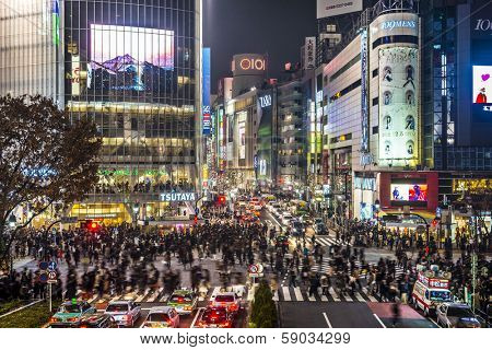 TOKYO, JAPAN - DECEMBER 15, 2012: Pedestrians cross at Shibuya Crossing. The intersection is known as the busiest in the world.
