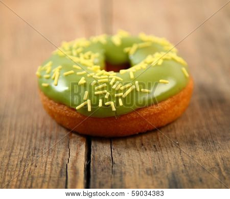 sweet bright donut on wooden background