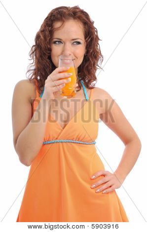 Beautiful Young Woman Drinking Orange Juice