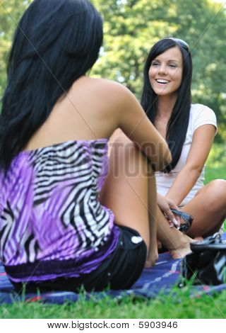 Two Friends - Women Talking Outdoors In Park