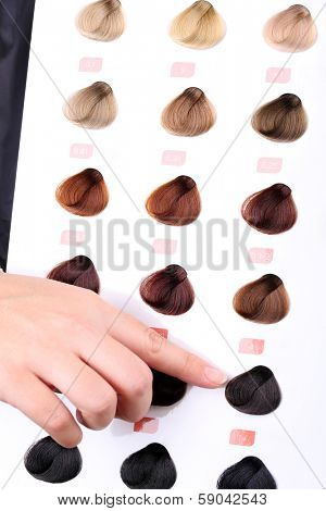 Hair stylist with hair samples of different colors, close-up