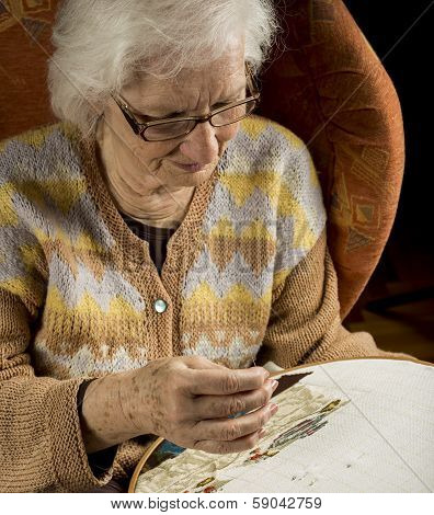 Portrait Of An Older Woman Needlepoint And Relaxing