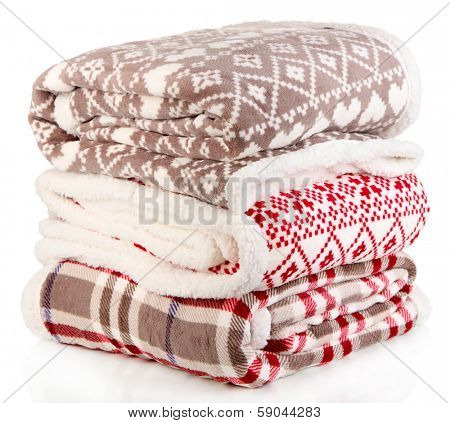 Pile warm plaids isolated on white