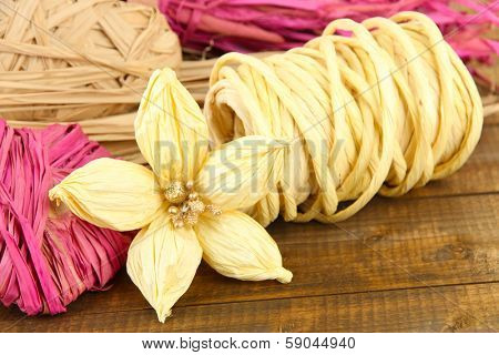 Decorative straw for hand made and flower of straw, on wooden background