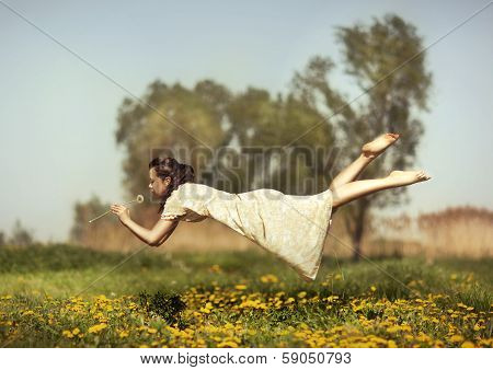 Girl Flies Over A Field.