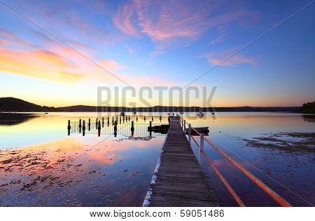 Colourful Sunset And Water Reflections At Yattalunga Australia