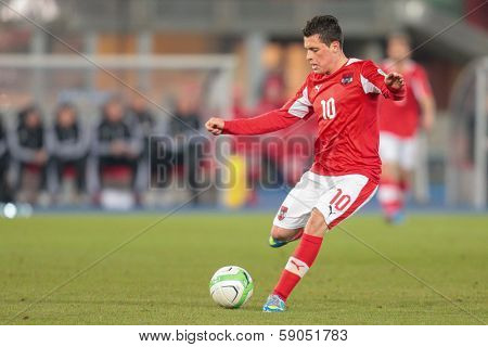VIENNA,  AUSTRIA - MARCH 22 Zlatko Junuzovic (#10 Austria) kicks the ball during the world cup qualifier game on March 22, 2013 in Vienna, Austria.