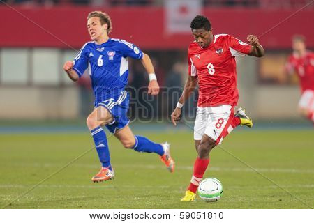 VIENNA,  AUSTRIA - MARCH 22 David Alaba (#8 Austria) runs with the ball during the world cup qualifier game on March 22, 2013 in Vienna, Austria.