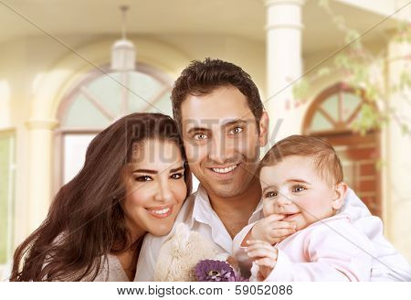 New family house, successful young parents with little baby having fun in country house, young cheerful owner of real estate, happy lifestyle concept