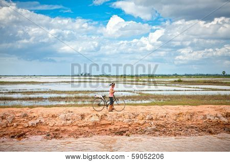 SIEM REAP, CAMBODIA-NOV 22, 2013: Unidentified Cambodian people live beside Tonle Sap Lake in Siem Reap, Cambodia on Nov 22, 2013. Tonle Sap is the largest freshwater lake in SE Asia peaking at 16k km2