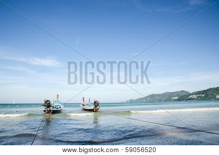 Wooden Longboat At A Beach In Phuket, Thailand