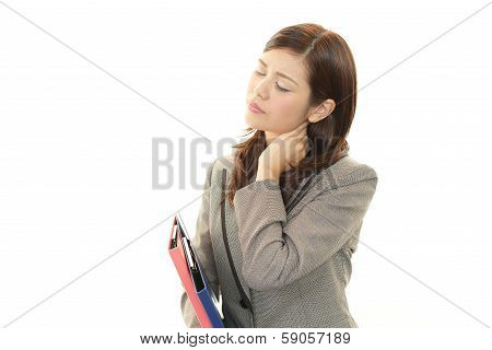 Business woman with neck pain.