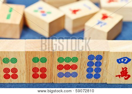Wood Tiles Closeup In Mahjong Game On Blue Cloth