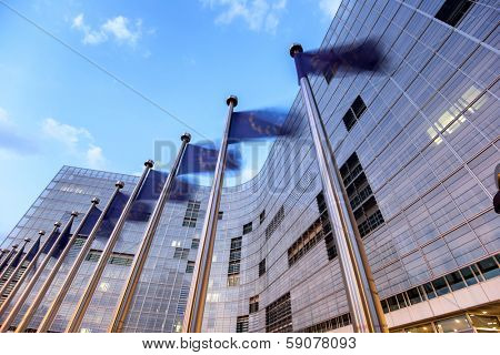 Waving flags of European Union in front of European Comission building in Brussels