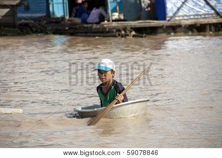 TONLE SAP LAKE, CAMBODIA - CIRCA APRIL 2012: Cambodian boy. Tonle Sap Lake.