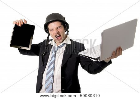 Angry Business Man Wearing Helmet Holding Laptop And Tablet