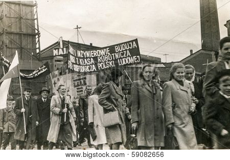BIELSKO, POLAND, CIRCA FORTIES - Vintage photo of 1st May parade - people marching with big communist propaganda banners