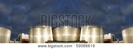 oil and fuel industrial panoramic, storage tanks at sunset
