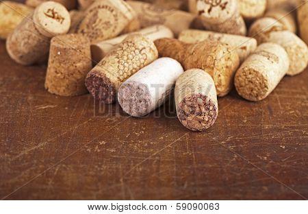bottle corks on the wooden background