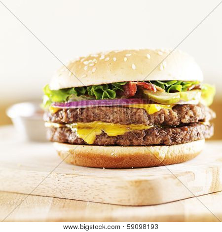 double cheese burger with bacon wide shot